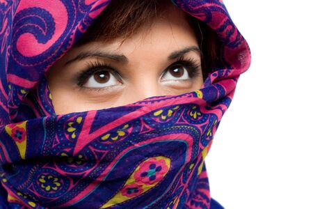covering: An attractive woman wearing a traditional head covering.