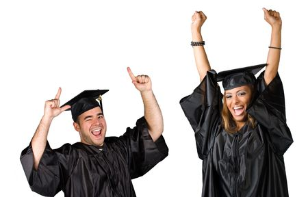 Two recent graduates posing in their caps and gowns isolated over white. Stock Photo