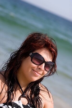 Portrait of a pretty plus size model at the beach. photo