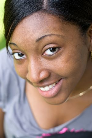 Portrait of a young Jamaican woman with a natural smile. Shallow depth of field. photo