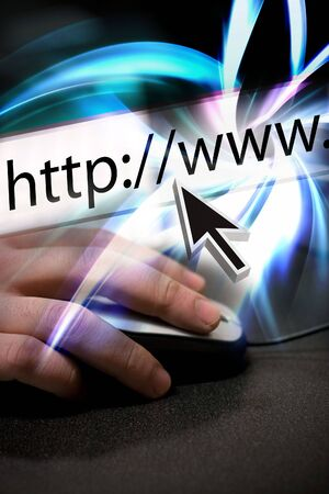 Montage of a mouse arrow pointing the the URL in the internet browser address bar and a hand using a mouse. Stock Photo - 6124466