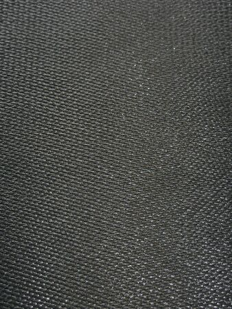 gunmetal: Raw carbon fiber material in its raw form prior to the clear epoxy finish. Stock Photo