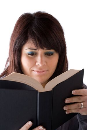 A young woman reading a book with a concerned expression on her face. Stock Photo - 6155876