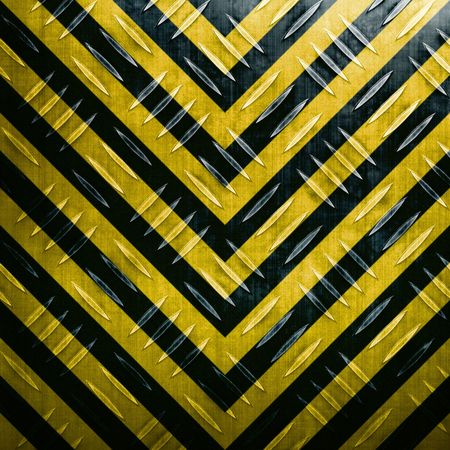 steel industry: A diamond plate texture with yellow and black hazard stripes paint scheme.  Texture shows wear with the silver showing through. Stock Photo