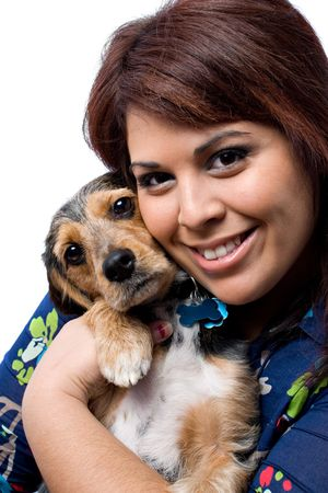 beagle mix: A young woman cuddling with a cute mixed breed puppy isolated on a white background. The dog is half beagle and half yorkie terrier.