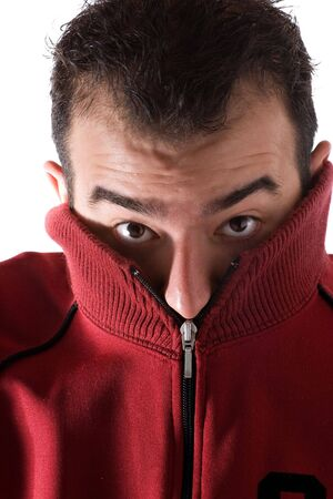 A cold man shivering and burying his face into his sweater. A great concept for HVAC. Stock Photo - 6285795