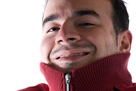 A young man covering his neck with his sweater because he is cold. A great concept for HVAC. Stock Photo - 6315797