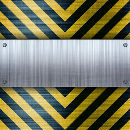 A riveted brushed aluminum plate on a construction hazard stripes background with carbon fiber inlay.  photo