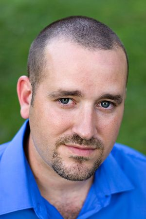 goatee: Portrait of a handsome man with a goatee in his early 30s.