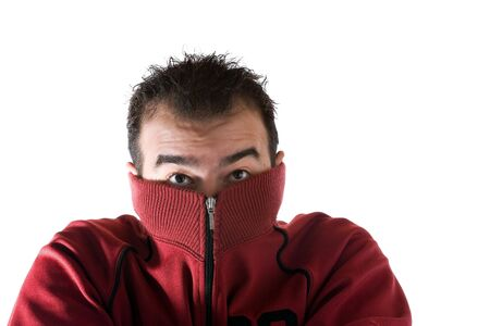 A cold man shivering and burying his face into his sweater. A great concept for HVAC. Stock Photo - 6394450