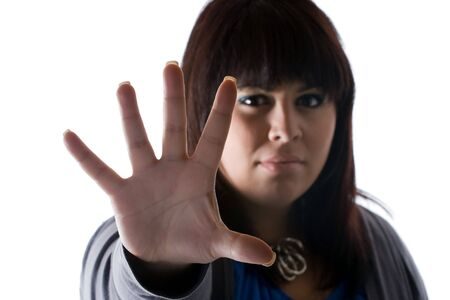 védekező: A woman holds up the palm of her hand in a defensive manner.  Shallow depth of field.