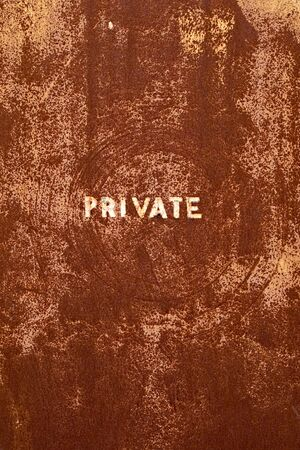 rusted: A rusted door panel that reads PRIVATE.