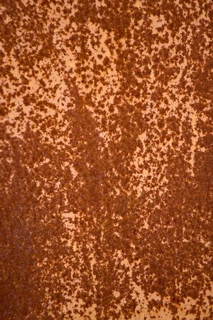A rusted metal texture with an orange tone. photo