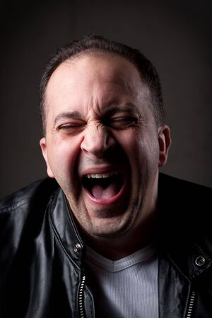 bewildered: A man laughing hysterically at something hilarious with a funny expression on his face. Stock Photo