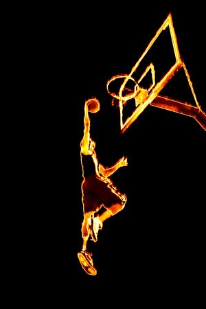 Abstract illustration of a fiery burning basketball player going up for a slam dunk.