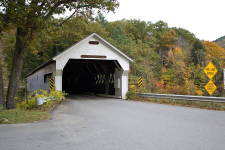 covered bridge: A historic New England covered bridge located in Dummerston Vermont.