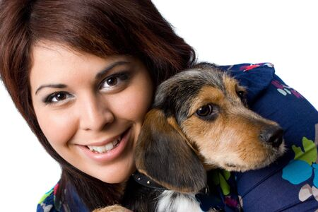 beagle mix: A young girl holding a cute mixed breed beagle yorkie dog isolated on a white background.