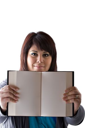A twenties plus size model holding up a book with blank pages and copyspace. photo