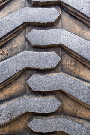 Rubber tire tread texture of a tractor or other heavy duty construction machinery. Stock Photo