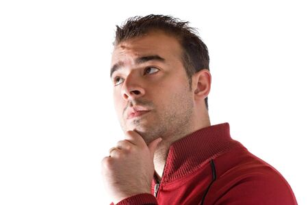 A young man thinking about something deeply with his hand on his chin.   Stock Photo - 6610920