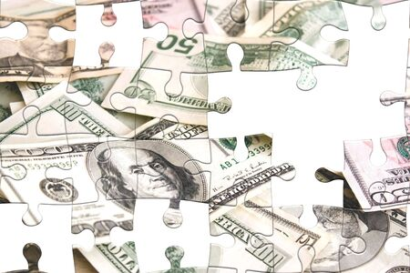 hard times: Photo montage with puzzle pieces and scattered money.