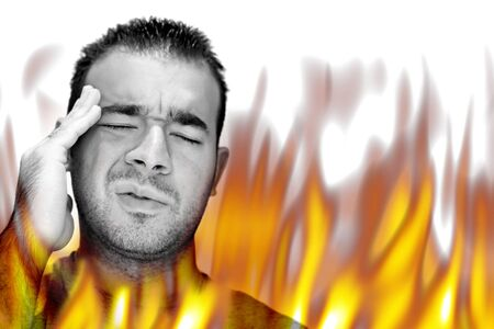 experiencing: A man experiencing pain and suffering with hot fiery flames burning around him.