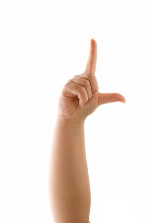 disrespectful: A hand holding up the loser sign or letter L with two fingers isolated over white. Talk to the hand! Stock Photo