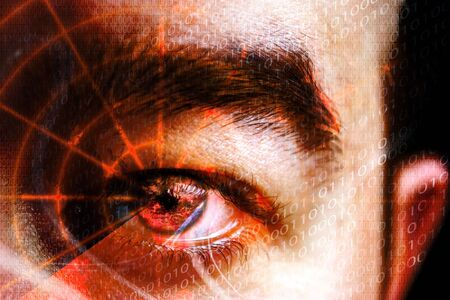 spies: Abstract montage of a mans eye with a radar grid overlaying the pupil.  Shallow depth of field. Great concept relating to cyber crime hackers or identity theft.