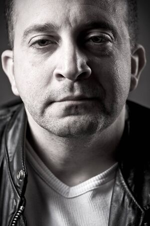 shady: Portrait of a serious middle aged man.  Shallow depth of field. Stock Photo