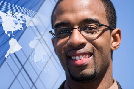 A smiling African American man over a world map conceptual background. photo