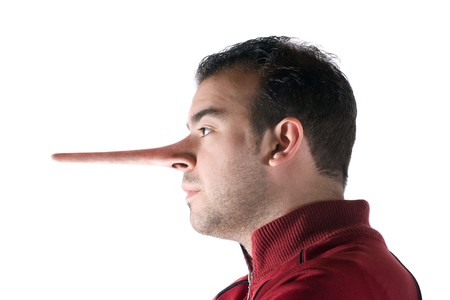 A dishonest man has a nose that grew long when he lied just like in the story of Pinocchio. Stock Photo - 6894321