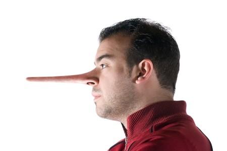 Een oneerlijk man heeft een neus die groeide lang wanneer hij loog net als in het verhaal van Pinocchio.  Stockfoto