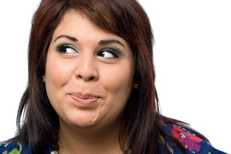 plus sized: A Hispanic woman isolated over white with a mischievous look on her face.
