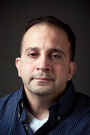 Portrait of a middle aged man in his upper thirties with a serious or concerned expression on his face. photo