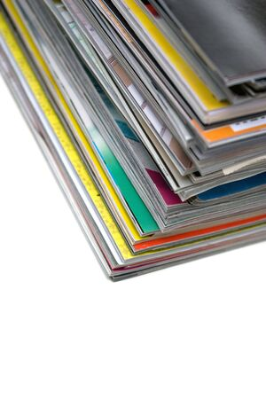 pornography: A large stack of magazines piled high isolated over white with copyspace.  Shallow depth of field. Stock Photo