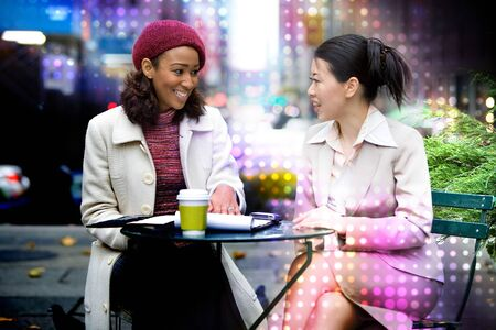 Two business women having a casual meeting or discussion in the city with an abstract glowing halftone circles effect. Stock Photo - 7054489