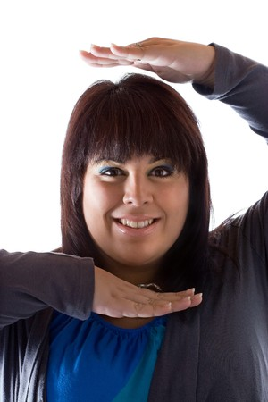 plus sized: A young plus sized modle posing with her hands as if she is framing herself. Stock Photo