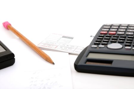 Adding up the monthly expenses for household accounting.  A calculator pencil and paperwork.  isolated over white. Stock Photo - 7135110
