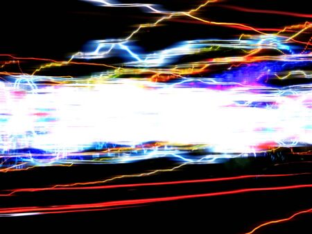 Abstract illustration of colorful glowing trails of light isolated over a black background. illustration