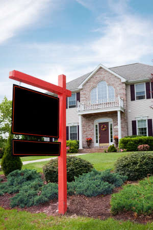 realty: A nice luxury home with a blank for sale sign posted in front.  Plenty of copy space on the empty sign for your text. Stock Photo