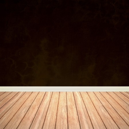 flooring: An empty room interior backdrop with hard wood flooring and a brown grungy wall.