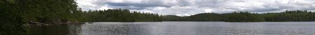 long lake: A wide angle panoramic view of the lower Saranac Lake and islands located in the upstate New York Adirondacks. Stock Photo