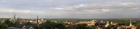 far off: A wide angle panoramic view of downtown New Britain Connecticut with the Hartford skyline also visible far off in the distance.