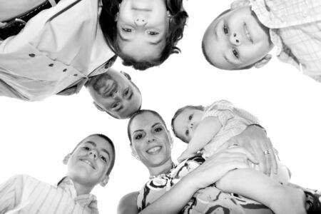 A happy family posing in a group huddle formation with a unique perspective. photo