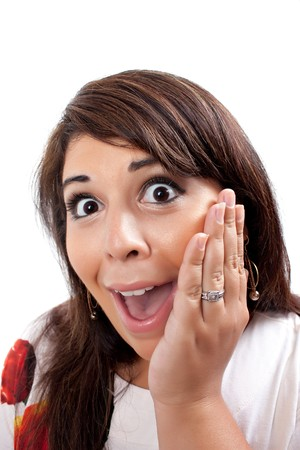 This young hispanic woman looks totally and completely surprised. She just found out something that was absolutely unbelievable. photo
