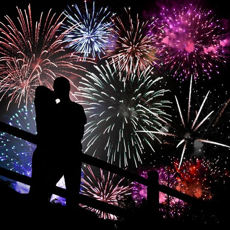 firework: A silhouette of a kissing couple in front of a huge fireworks display.