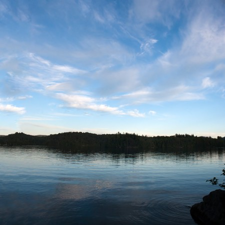 long lake: A view of lower Saranac Lake and islands located in the upstate New York Adirondacks around dusk.