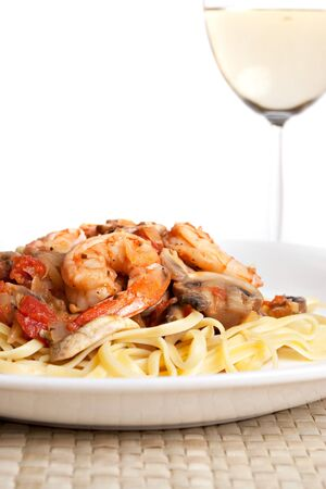 pinot: A delicious shrimp scampi over linguine dish along with a glass of pinot grigio white wine.  Stock Photo