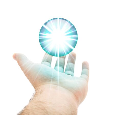 hand held: A hand being held out with a blue orb or round button hovering above the palm.