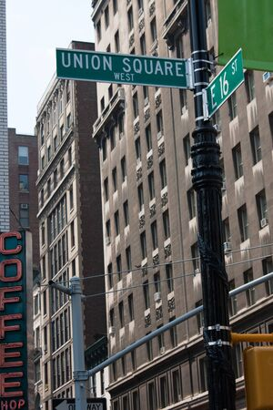 square: A sign post at the intersection of two streets reading UNION SQUARE WEST and E 16 ST.  Remove the words and insert your own to easily customize the message. Stock Photo